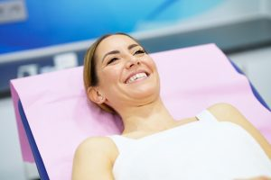 Middle-aged woman lying on the stretcher in an aesthetic clinic